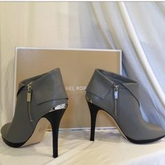 """NEW! MK KENDRA BOOTIES! 8.5 ❤️ BRAND NEW! IN BOX! MK KENDRA Grey leather peep toe booties! STUNNING !! Butter soft , supple steal grey leather bootie,  lends itself to a sexy black 4.5 """" heel , size 8.5 W/ silver Michael Kors back logo heel plate ! These little beauties are seriously comfy! & super stylish ! ❤️ LESS $ ON MERCARII !! Michael Kors Shoes Ankle Boots & Booties"""