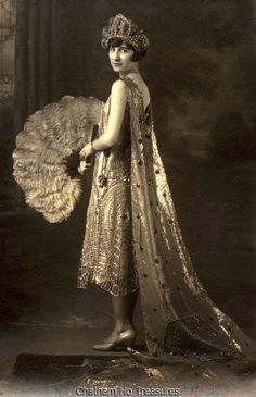 1927 Flapper Girl with fan and headdress (Mardi Gras queen)