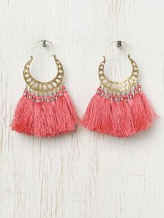 All gypsies need pink feathered tassels hanging in their ears, by Free People