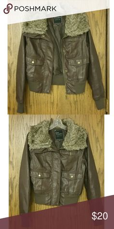 Leather Jacket With Fur False leather jacket with fur. Very cute and warm. Looks best with a white tshirt underneath and jeans. Pictures does not do its justice. Jackets & Coats