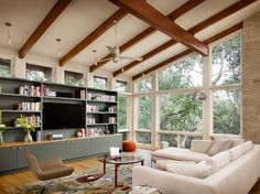 Wood beams accent the sloped ceiling in this space