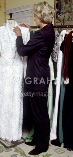 April 23, 1997: Diana, Princess of Wales with designer, Catherine Walker dress in Kensington Palace.