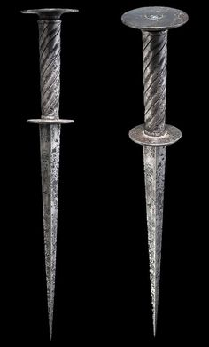 """A German roundel dagger, First half of the 16th century  Strong, tapering blade of hollow-ground quadrangular section. Iron spirally-fluted grip. Flat roundel pommel. Length 32 cm (12.6"""")  Copyright © Hermann Historica Auction House"""