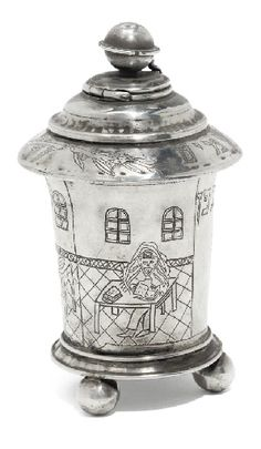 "AN UNUSUAL POLISH SILVER COMBINED KIDDUSH CUP & SPICE CONTAINER  STRUCK WITH AN '84' STANDARD MARK ONLY, 2nd HALF 19TH CENTURY  The cup of beaker form with flared lip, on three ball feet, engraved with a fruiting vine, a rabbi seated at a table, studying a holy book, a dining room with a table set for the Sabbath meal including bread, fish & a lit candelabrum, a chandelier, cover secured by a small clasp & engraved around the rim with the Hebrew blessing for spices & a flowering branch  5½""…"