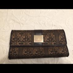 Clutches And Wallets Brown and gold wallet, has plenty of room for credit cards, and a check book also has zipped pocket inside and on back Liz Claiborne Bags
