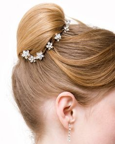 Gorgeous combination of bridal bun updo with hair accessories.