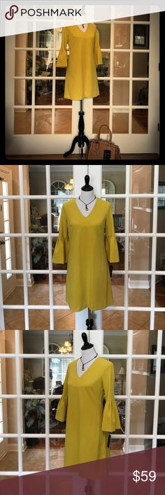 """🆕 Donna Morgan Mustard Dress with Pockets This Donna Morgan dress is a mustard color and has great stretch.   Dress even has pockets!!  Love that!   Size is labeled a 4, but seems like it could fit a larger woman bc of the way it lays on the small mannequin.  I could be wrong.  All I know is I'm too big for it. 🤣   Laying flat, from armpit to armpit Bust is about 19"""" and waist is about 17."""" Donna Morgan Dresses"""