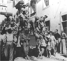 Brazilian soldiers greeted by citizens of Montese, Italy. FEB troops liberated the town in April 14, 1945.