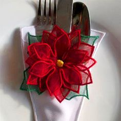Add a festive flourish to your holiday table with a set of 3D and fill poinsettia decorations from Mar Lena Embroidery.