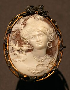 A Fabergé cameo, diamond, silver, and gold brooch.