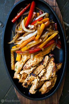 The BEST chicken fajitas! Marinated chicken breasts seared quickly and served with seared onions, bell peppers, and flour tortillas.
