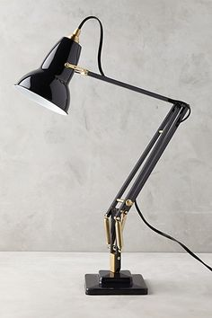 Anglepoise Original 1227 Desk Lamp - something like this. Too expensive itself