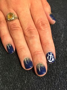 Navy and gold gel nails