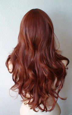 Color: Auburn Style : Long wavy hair Over all length: 26 inches Part: Circle center part can be parted on either side of the face Bangs length: 9-10
