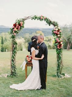 Tuscan rose adorned arch: http://www.stylemepretty.com/vault/gallery/38400 | Photography: Sarah Kate - http://sarahkatephoto.com/