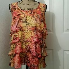Just in time for warm weather ruffled tank top Fun ruffled Sleeveless top fully lined in yellow. Key hole with button closure in the back. Slinky Tops Tank Tops