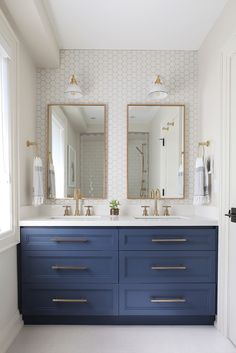Bathroom Remodel Deep blue painted cabinets in an otherwise all white bathroom. I also love the h. Deep blue painted cabinets in an otherwise all white bathroom. I also love the hexigon tile wall, and the long lines of the mirrors - Collective Studio Bathroom Vanity Designs, Bathroom Layout, Bathroom Interior Design, Bathroom Ideas, Bathroom Organization, Bathroom Cabinets, Bathroom Vanities, Bathroom Storage, Bath Ideas