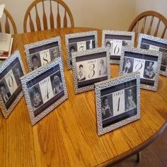 table pictures/numbers with bride and grooms pictures as a child :) by ethel