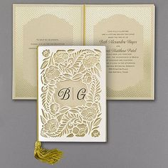Tell Your Story Wedding Invitation 40% Off | http://mediaplus.carlsoncraft.com/Wedding/Wedding-Invitations/3285-RZN38780-Tell-Your-Story--Invitation.pro | Carlson Craft Invitation RZN38780 Your wedding - storybook style! Guests open the laser-cut wrap to read your romantic details on four gold shimmer pages with gold foil designs. A gold tassel joins the pieces.