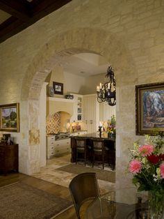Stone wall with arch opening separates Kitchen from Family Room...