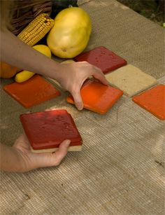 spray paint 4-inch tiles and lay them out as a table runner. shows fall colors but easy to mix up. tiles double as trivets.