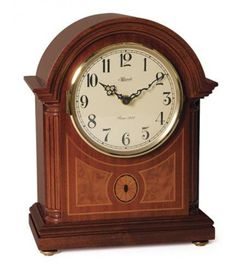 Hermle Clearbrook Barrister Style Mantel Clock 22877-070340-072115. h1Hermle Clearbrook Barrister Style Mantel Clock 22877-070340-072115_h1The Hermle Clearbrook Barrister Style Mantel Clock 22877-070340-072115 comes in a rich mahogany finish with fluted columns and equisite inlaid marquet.. . See More Mantel Clocks at http://www.ourgreatshop.com/Mantel-Clocks-C1124.aspx