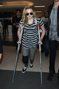 Pin for Later: Can't-Miss Celebrity Pics!  Chloë Grace Moretz was a good sport in crutches at LAX on Wednesday.