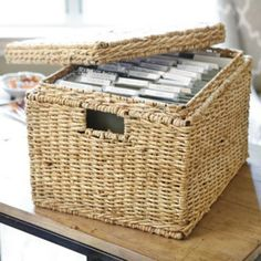 Woven File Box - Letter Size - Our woven file storage box holds letter-size files in your home office, magazines in the family room and helps organize clutter anywhere. Metal rails inside hold standard hanging files. Lid keeps paperwork hidden and helps keep dust out.    Woven File Box features:  Coordinates with our Woven Office Accessories, Hand woven of natural maize & rattan, Sturdy iron frame