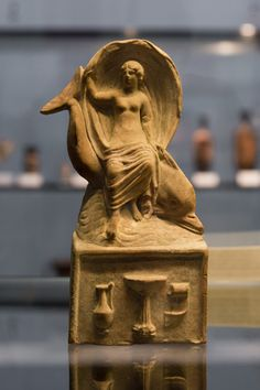 """Aphrodite riding a dolphin 