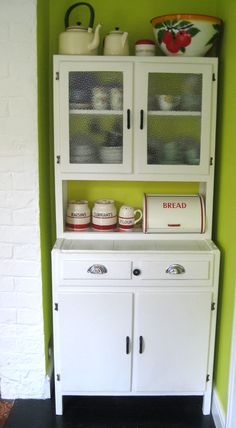 Super sweet 1950's Kitchen Cupboard. Glass doors up top with a red ...