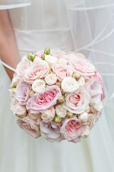 Gorgeous bouquet.  Rose Filled English Wedding In The Cotswolds - Bridal Musings Wedding Blog
