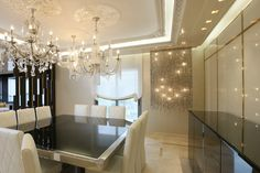 luxury modern dining...cascading crystals, back painted glass with golden frame, and ipe cavalli furniture