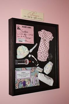 Shadow box with baby's stuff from the hospital.