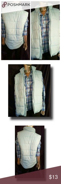 Everyday Living Basics Puffer Vest Create the perfect fall outfit with this soft blue Puffer vest.  DETAILS: Lining:100 % Nylon   Filler: 100% Polyester  Shell:100%Polyester  Machine wash cold inside out. Delicate cycle with like colors.  Smoke & pet free home. No damages to the garment. New with tag. Everyday Living Basics Jackets & Coats Vests