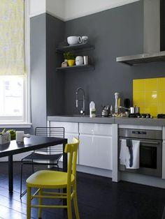 gray + yellow kitchen trying this in my condo no cupboards just shelves on one side I'm doing grey and purple with apple green accents. Dark wood floor