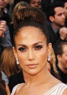 Jennifer Lopez is stunning in diamond earrings by Lorraine Schwartz.