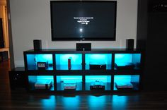 DIY Gaming Shelf, LED backlit. Some modding to basic bookshelves turned sideways and stacked together, backlit with RBG LED light strips provides an excellent shelving system for old and new consoles.