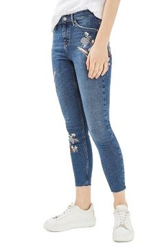 Free shipping and returns on Topshop Moto Jamie Embroidered Skinny Jeans at Nordstrom.com. Colorfully plumed birds visit romantic blossoms on high-rise skinny jeans with raw cropped hems to keep it edgy.