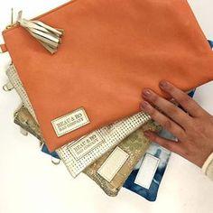 Sleek, flat clutch + crossbodies bags