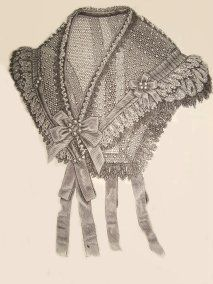 damn tulle (front): A small scarf tulle the year 1865      This is done by damn white silk tulle, drawing in black and white lace of various widths. The knots and loops of ribbon adorned with white pearls complement the filling .