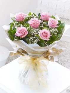 Featuring large headed pink roses hand-tied with gypsophila and salal and presented in Flowers.ie gift packaging. Order Flowers Ireland
