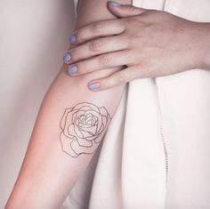 Minimalistic rose tattoo by Melina Wendlandt