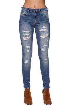 """The women'sHigh Rise Skinniest Cerulean Tide Jeans by Bullhead Denim Co offer a distressed wash with destroyed details throughout. We love the skinniest style and stretch fabric. Wear this jeans with our sweaters and ankle boots for a cute fall look!   High rise 10"""" rise 30"""" inseam Measured from a size 3 Model is wearing a 3 Her measurements: Height: 5'9"""" Bust: 32"""" Waist: 25"""" Hips: 35"""" 99% cotton, 1% spandex Machine ..."""