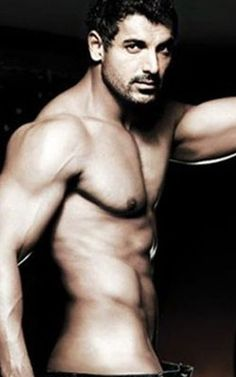 So, Mr. John Abraham...I saw a sexay pic of you in my favourite Indian restaurant, and I thought to myself...I shall have your babies, especially if you can make curried ANYTHING.