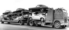 Six Ford Thunderbirds on a 1950's auto transport trailer