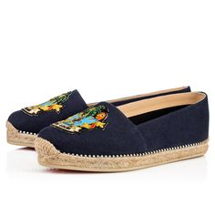 "Your Spring/Summer leisure look is sorted with ""Lougalia Flat"". This cool blue 'olona' canvas espadrille is given an air of distinction with this season's tropical 'Cario Loubi' crest patch. Keeping with tradition, all Christian Louboutin espadrilles are made in Spain."