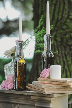 candles in glass bottles and vintage books // photo: l&v photography