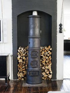 """I want a wood stove in my house someday. Maybe more than one - a wood stove, a fireplace, and one of those cool decorative iron/steel fire """"pits"""" outside on my lakeside deck. Cast Iron Fireplace, Open Fireplace, Stove Fireplace, Fireplace Design, Black Fireplace, Craftsman Fireplace, Cottage Fireplace, Fireplace Seating, Fireplace Kitchen"""