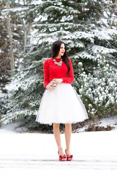 Shop this look on Lookastic:  http://lookastic.com/women/looks/necklace-crew-neck-sweater-clutch-full-skirt-pumps/6919  — Silver Necklace  — Red Crew-neck Sweater  — Silver Sequin Clutch  — White Tulle Full Skirt  — Red Leather Pumps