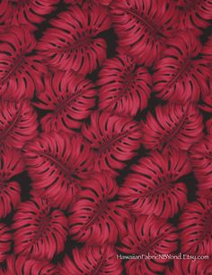 Fabric: Monstera leaves in mystic reds on a black background. By HawaiianFabricNBYond.Etsy.com